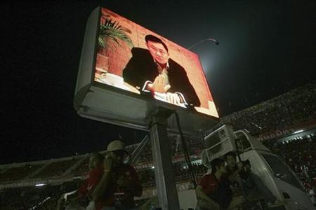 Former Thai Prime Minister Thaksin Shinawatra gives a live address to pro-government supporters during a rally at Rajamangala Stadium in Bangkok on November 1, 2008.